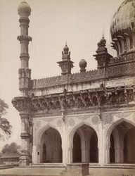 Close view of south minaret and portion of screen of the Mosque of the Ibrahim Rauza, Bijapur.